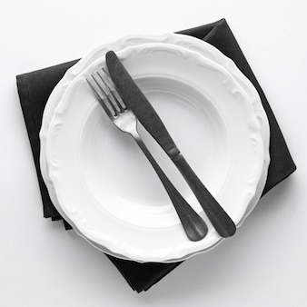 Top view of plates with cutlery and napkin