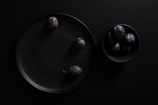 Top view plates with delicious blackberries