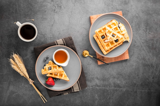 Top view plates with waffles with fruits