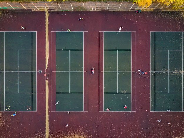 Top view play tennis on several courts aerial drone shot