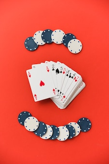 Top view playing cards with poker chips