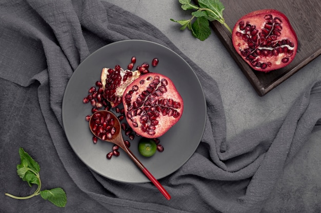 Top view of pomegranate on plate with mint