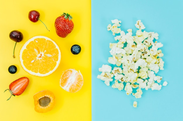 Top view pop corn vs fruit
