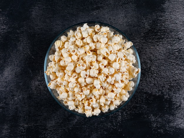 Top view of popcorn in bowl on black  horizontal