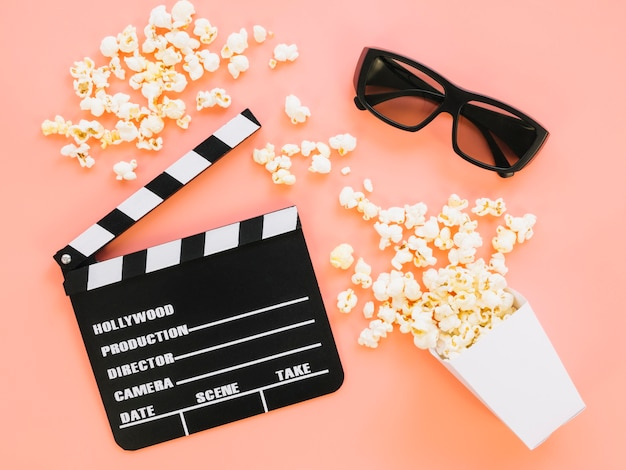 Top view popcorn with clapperboard and 3d glasses