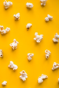 Top view popcorn on yellow background