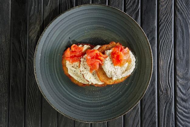 Top view of potato pancakes with salmon and mozarella