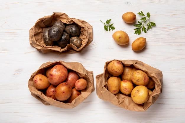 Top view potatoes in paper bags