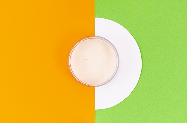 Top view powder on colorful background