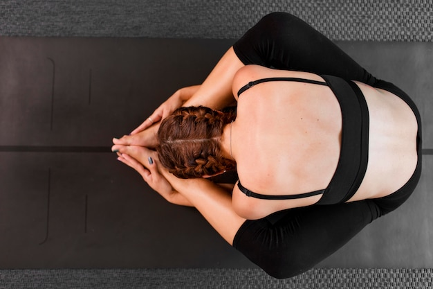 Top view practicing yoga at home concept