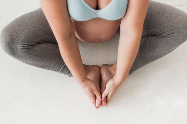 Top view pregnant woman doing exercises