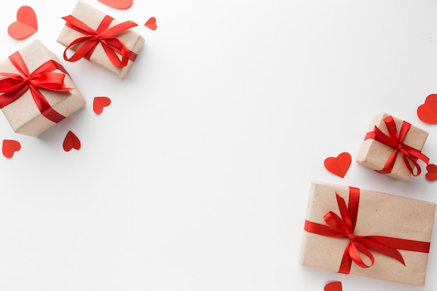 Top view of presents with hearts and copy space