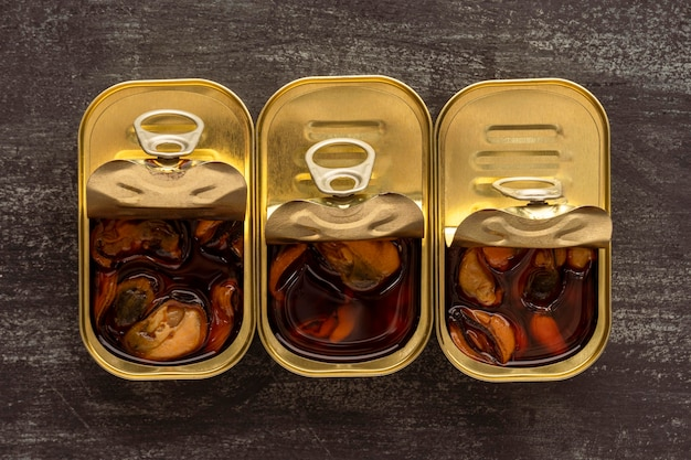 Top view preserved mussels in cans
