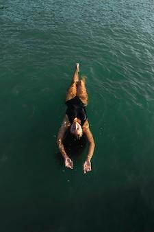 Top view pretty young woman enjoying swimming