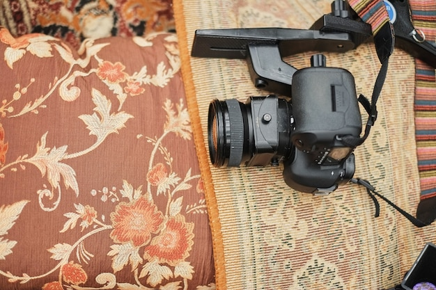 Top view, professional camera. objects on the light carpet floor videographer