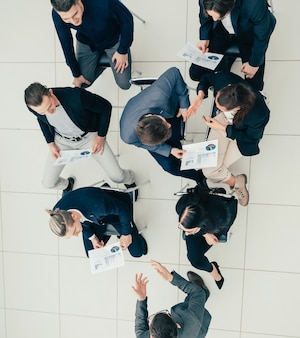 Top view project manager at a meeting with the working group