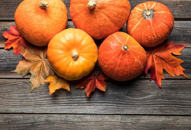 Top view pumpkins arrangement on wooden table