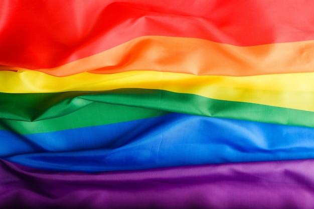 上面図の虹色の旗の背景、lgbtコミュニティの国際的なシンボル、多様性の兆候、権利における男女平等。