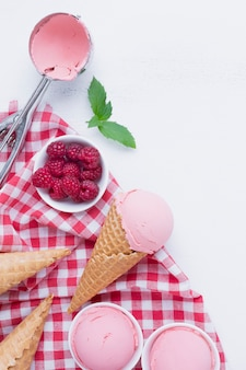 Top view of raspberries ice cream cones