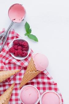 Top view of raspberries ice cream cones
