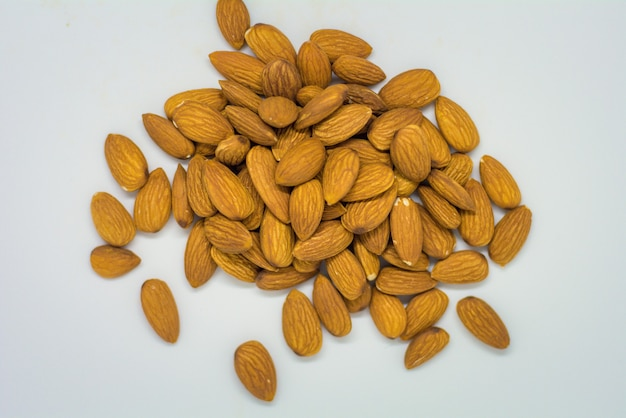 Top view of raw almond on white background isolates almonds in whitespace