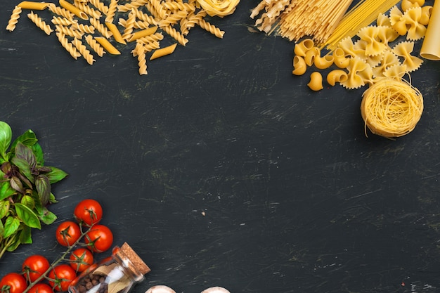 Top view of raw italian pasta background