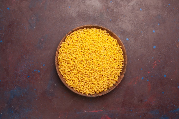 Top view raw italian pasta little formed on a dark background pasta raw meal food dough