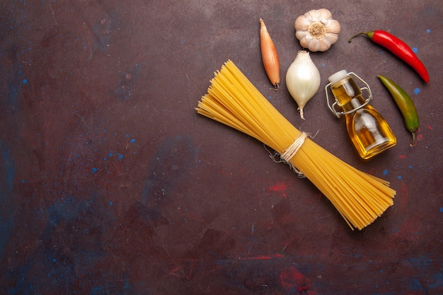 Top view raw italian pasta long formed on the dark-purple background meal food dough pasta raw