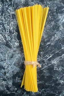 Top view raw long pasta on gray background kitchen pasta dough cuisine color food cooking kitchen