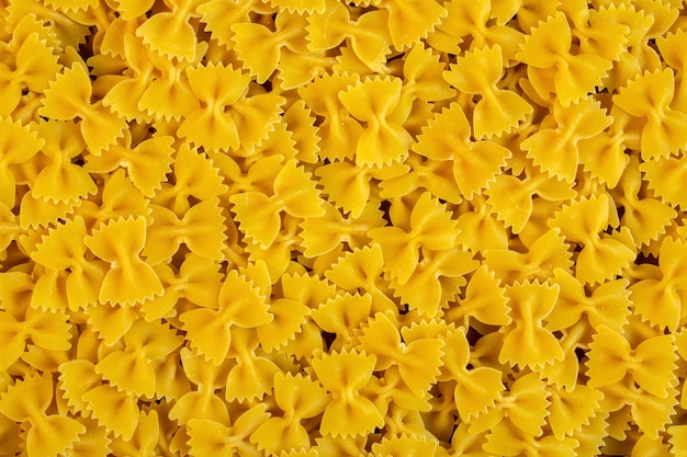 Top view of raw pasta farfalle seamless pattern