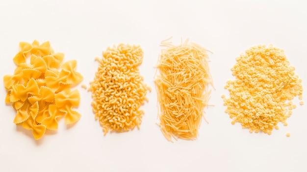 Top view raw pasta piles