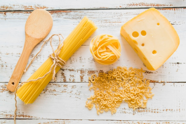 Top view raw pasta with cheese