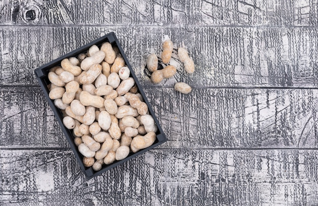 Top view raw peanuts on wooden  horizontal
