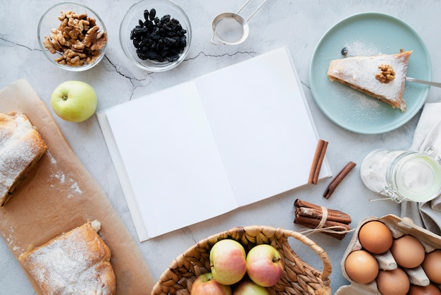Top view on recipe book still life concept