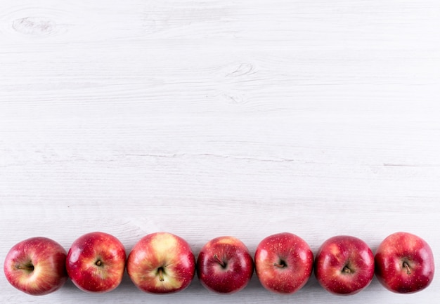 Top view red apples with copy space on white wooden  horizontal