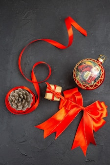 Top view red bow xmas ornaments on beige surface