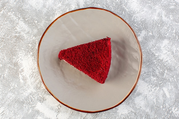 Top view red cake slice fruit cake piece inside plate on the grey background cake sweet tea