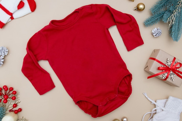 Top view red childrens tshirt mock up with sweater on colored with christmas decorations