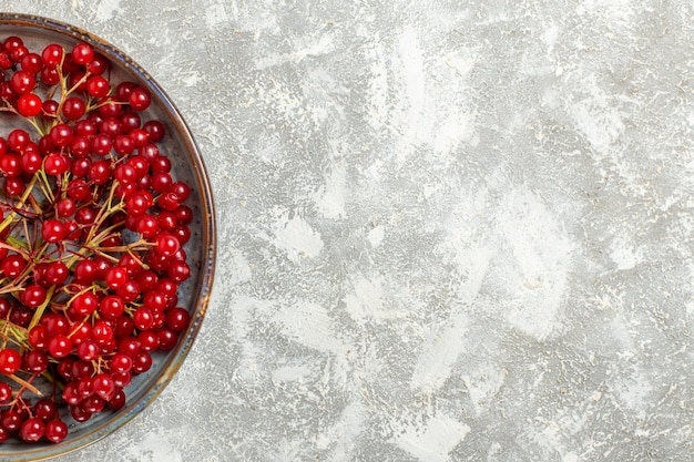 Top view red cranberries mellow fruits on the white background