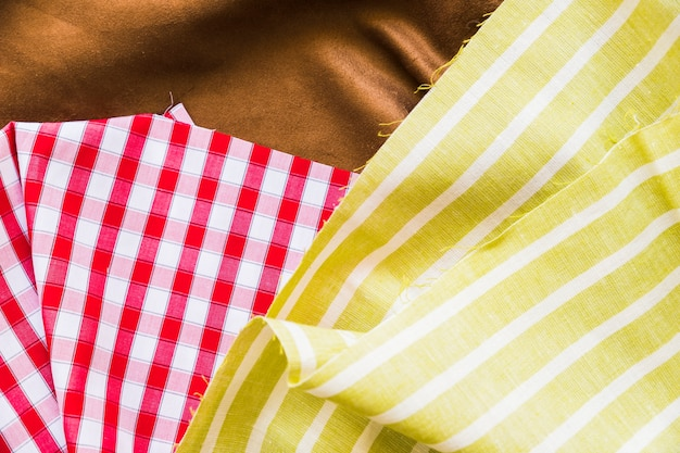 Top view of red gingham with two textile fabric