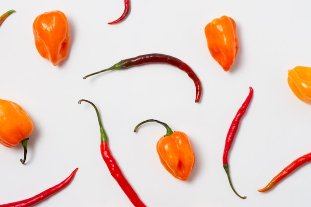 Top view red hot chili peppers with white background