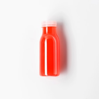 Top view of red juice bottle