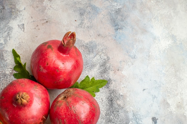 Top view red pomegranates on light background