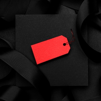 Top view red price tag on dark background