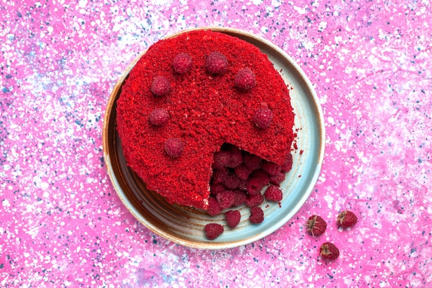 Top view of red raspberry cake baked delicious inside plate on the pink surface