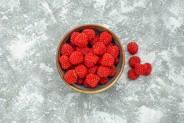 Top view red raspberry confitures inside pot on white background candy confiture sweet sugar tea