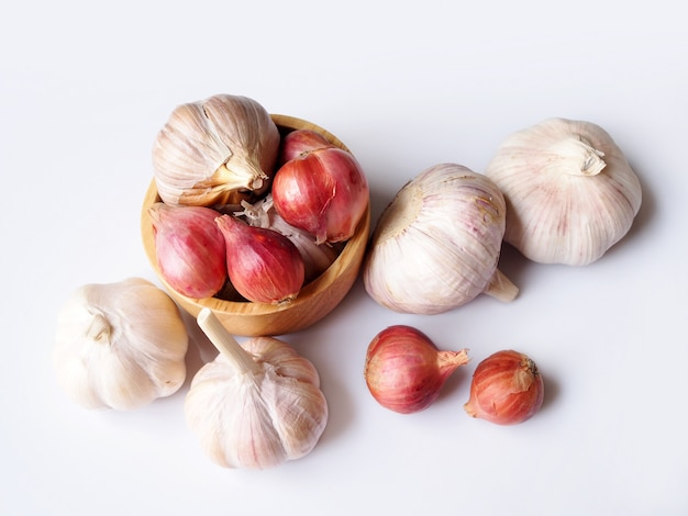Top view of red shallots, onion and garlic, herbs and spices for cooking isolated.