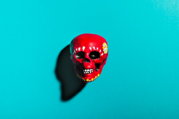Top view red skull on blue background