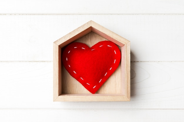 Top view of red textile heart in a house
