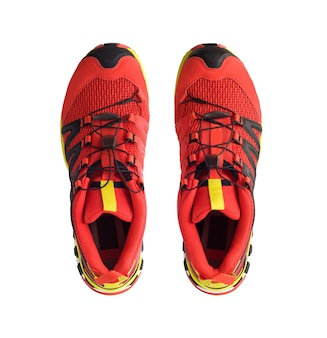 Top view of red trail running shoes or trekking boots isolated on white background